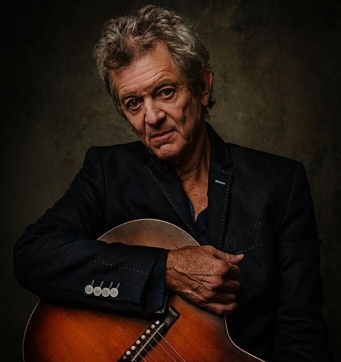 Man with Guitar named Rodney Crowell