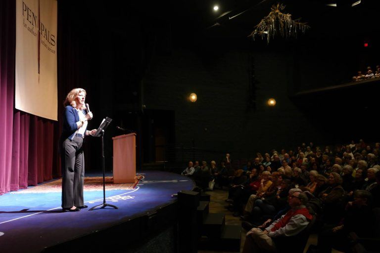 Pen Pals Author Lecture Series woman speaking on stage in front of audience